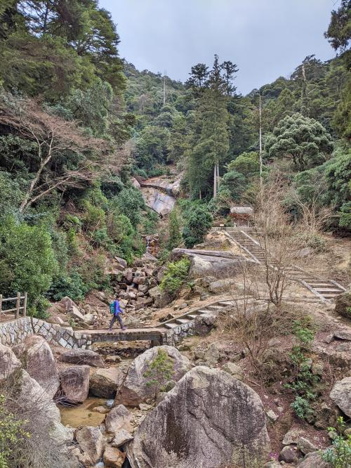 Jackie Szeto from Life Of Doing walks along the Mount Misen's Daishoin Course hiking path.