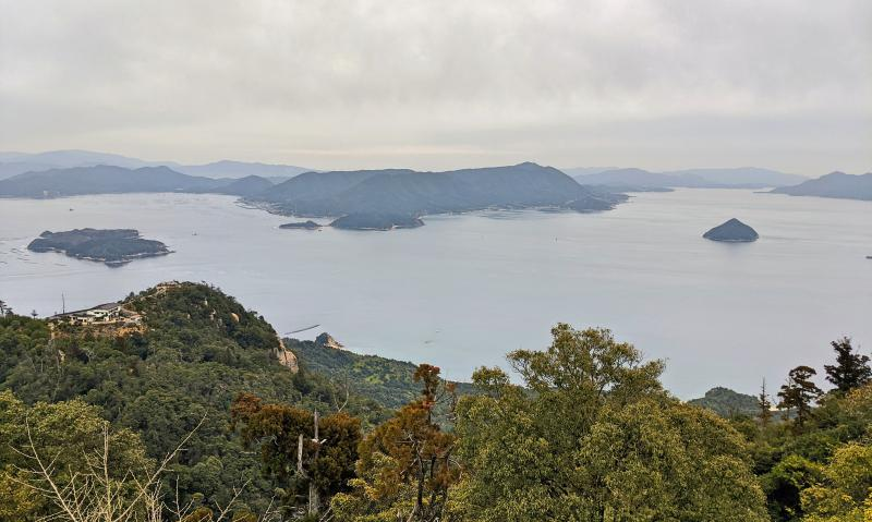 At the Mount Misen summit, you see the surrounding islands of Miyajima and the waters.