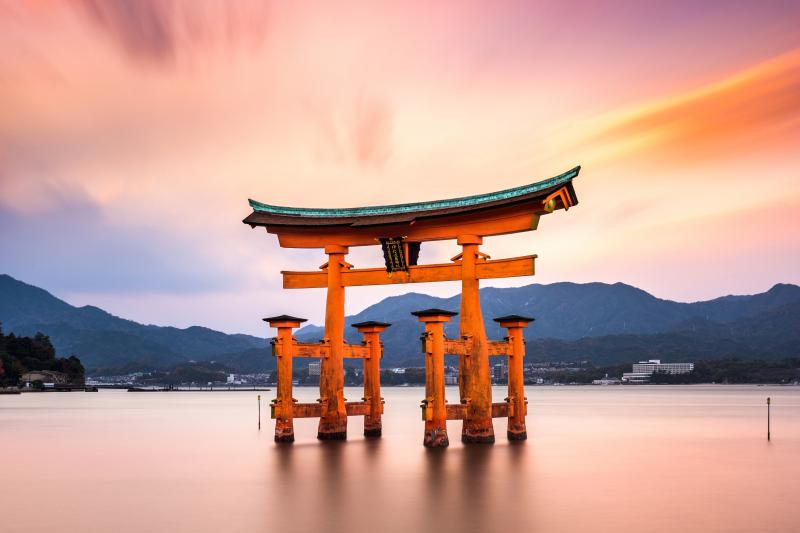 The floating torii gate, Otorii, in Miyajima, Japan with the sunset.