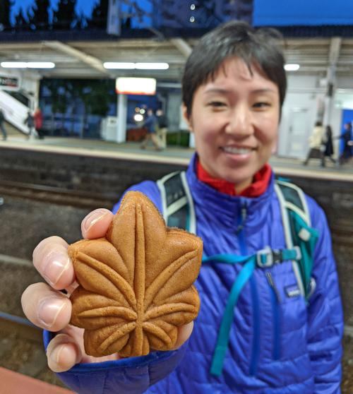 Jackie Szeto from Life Of Doing holds a momiji manju, a Japanese maple leaf shaped cake with filling inside. Made in Miyajima, Japan.