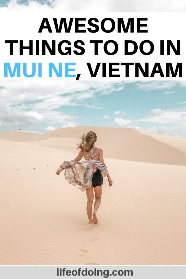 In this post, we're sharing the top things to do in Mui Ne, Vietnam such as visiting the red and white sand dunes, fishing village, beaches, and more. In the photo, a woman walks along the white sand dunes.