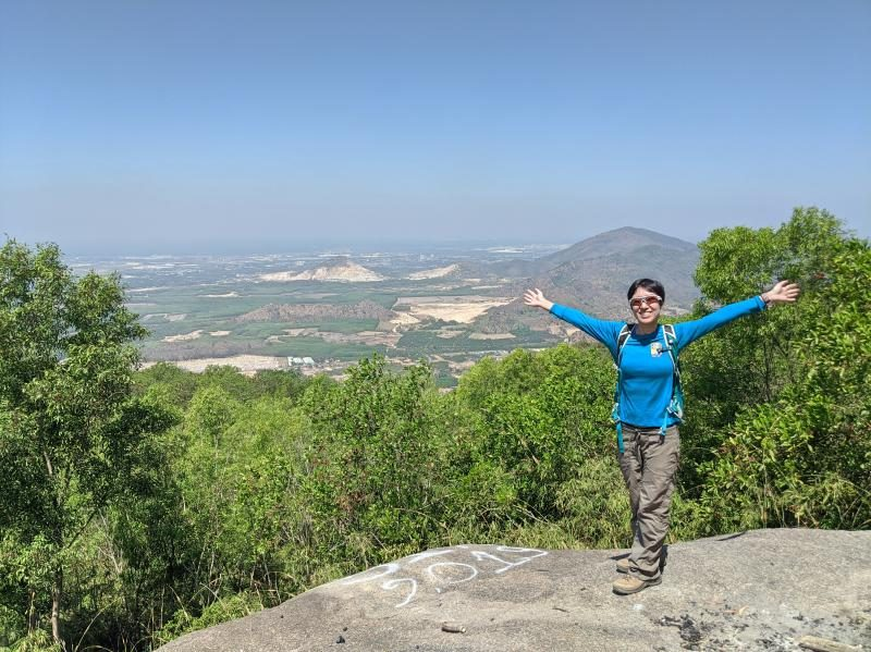 Jackie from Life Of Doing reaches the peak of the Nui Dinh Mountain. It's a great spot as a day trip from Ho Chi Minh City, Vietnam.