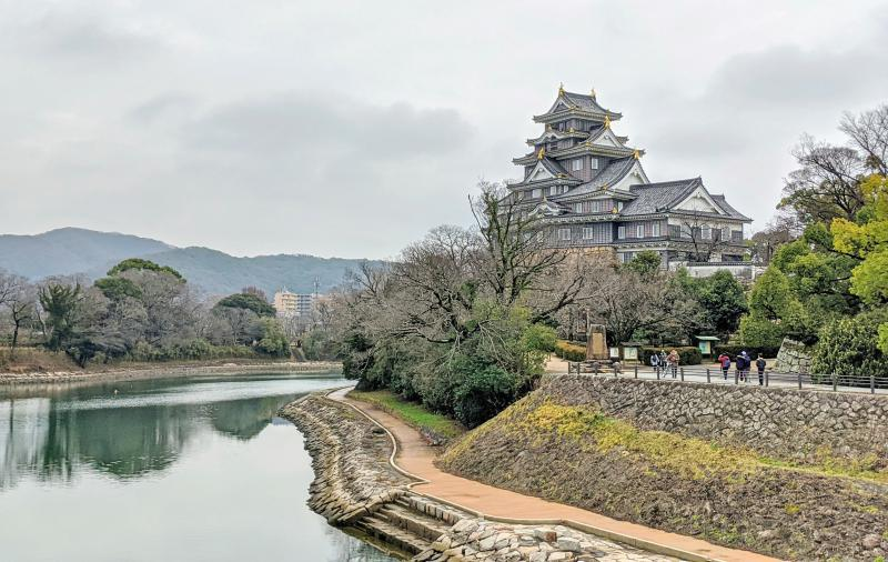 South view of the Okayama Castle with the river and walkway.