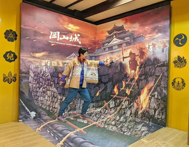Jackie Szeto from Life Of Doing interacts with 3D artwork inside Okayama Castle.