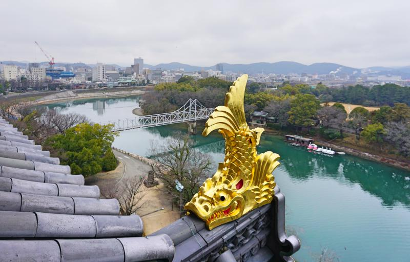 This photo is taken from the top level of the Okayama Castle where you see the gold shachi, lake, and a view of the Okayama Korakuen Garden.