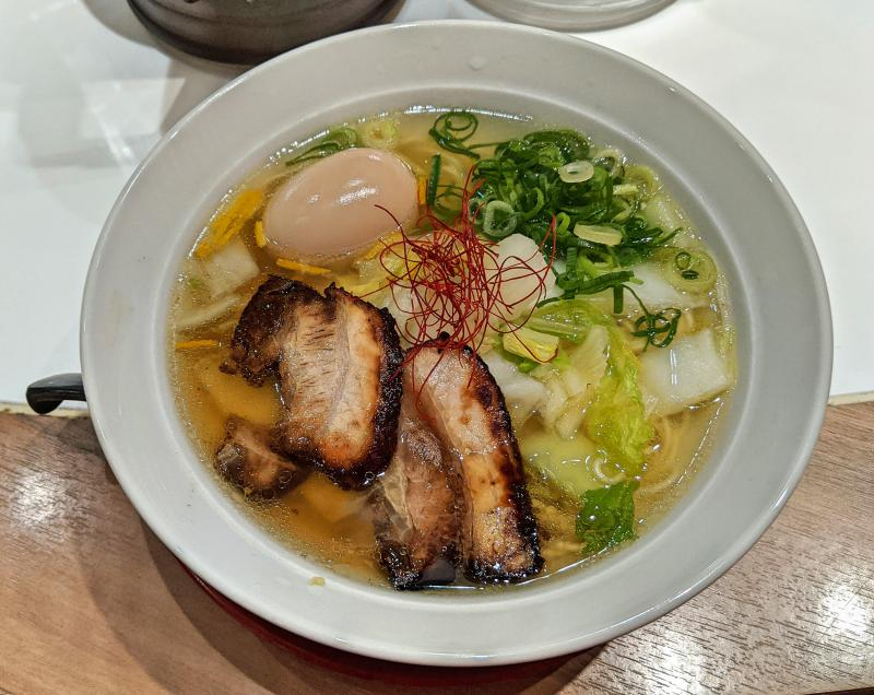 Shima soba with the sea bream soup, napa cabbage, soft boiled egg, and roast pork at Shodoshima Hishio Ramen Okayama Ekimae in Okayama, Japan.