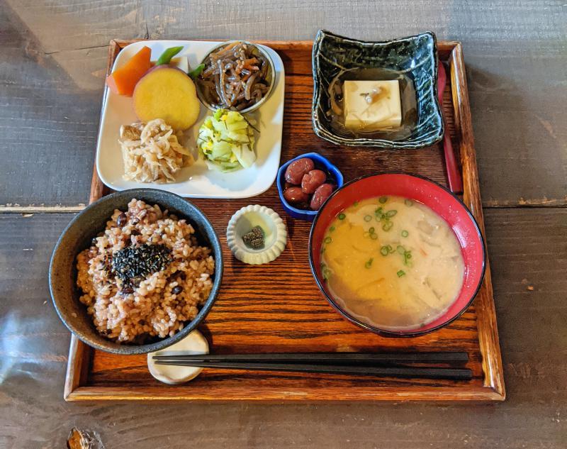 Vegetarian lunch of brown rice, miso soup, tofu, beans, and pickles at Genmai-Shinshoku Aisunao in Naoshima, Japan.