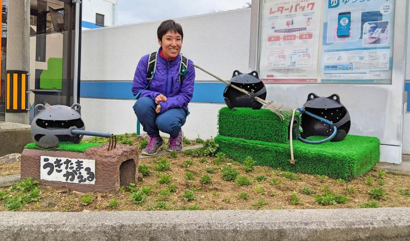 Jackie Szeto from Life Of Doing poses with frogs racking and gardening in Naoshima Island, Japan. The frogs are made out of recycled floating buoys.