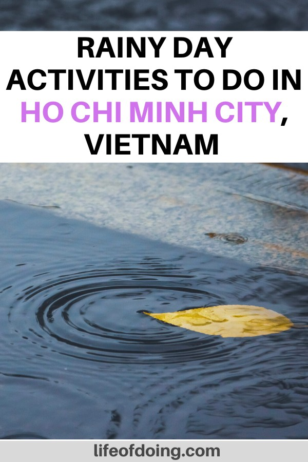 We're sharing the top things to do in Ho Chi Minh City on a rainy day or during the rainy season. Photo is of a yellow leaf in a water puddle on the ground.