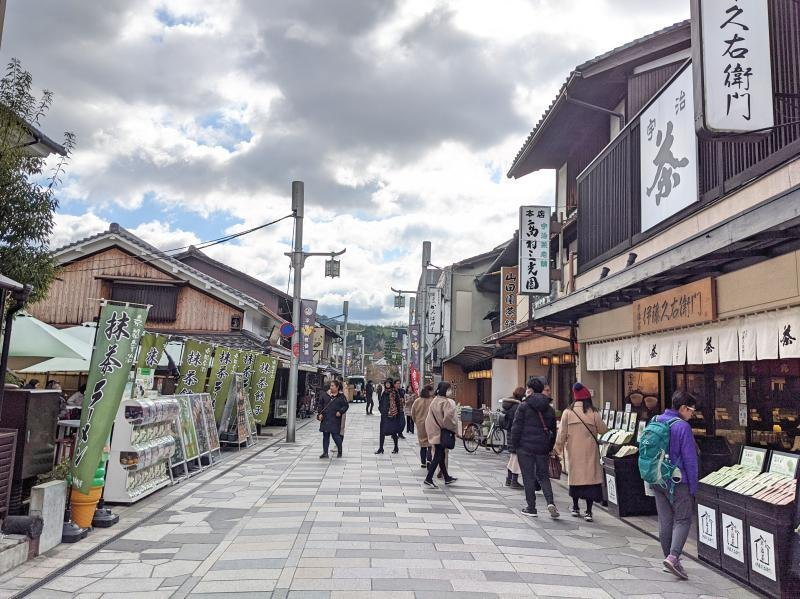 Byodoin Omotesando Street is a fabulous spot to visit on your Uji day trip. Shop for tea and souvenirs and eat matcha foods and desserts.