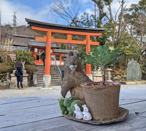 The Uji Shrine is a small shrine area with orange torii gates and bunny decorations. It's a good spot to visit during your Uji day trip in Japan.