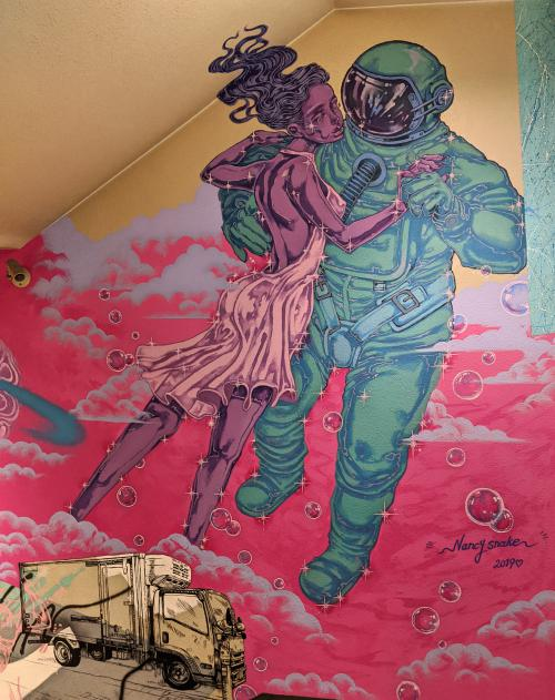 Artwork of a woman dancing with an astronaut. It's located in the Magnet by Shibuya 109 shopping mall in Tokyo, Japan.