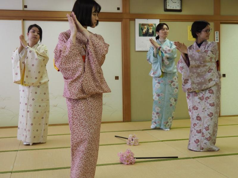 Four women in kimonos learn the nihon buyo traditional dance in Tokyo, Japan.
