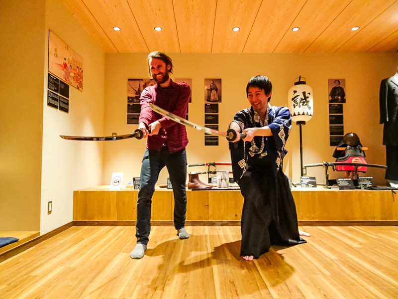 Two men practice samurai sword fighting at the Samurai Museum in Tokyo, Japan