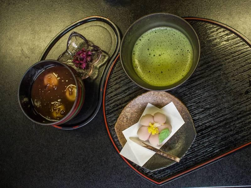 Eating sweets and matcha desserts at the Koishikawa Korakuen Garden Tea House in Tokyo, Japan.