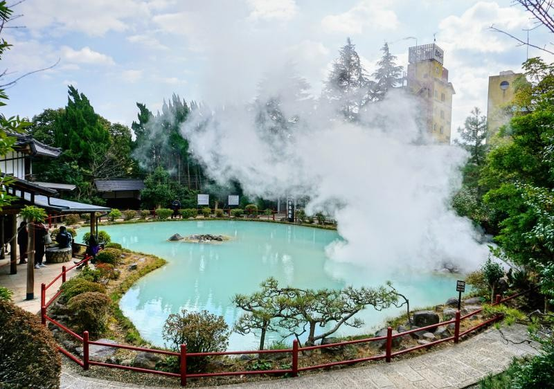 Shiraike Jigoku is one of the Hells of Beppu sites to visit in Beppu, Japan with the milky blue hot spring and steam.
