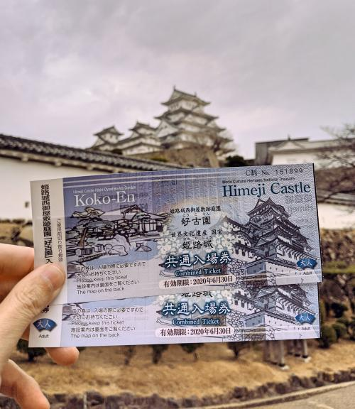 Justin Huynh, from Life Of Doing, holds up the combination ticket of the Himeji Castle and Koko-en Garden.
