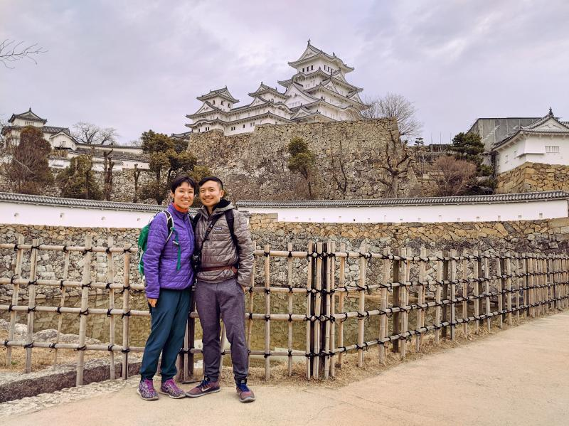 Jackie Szeto and Justin Huynh, Life Of Doing, spend the day in Himeji, Japan and take a photo at the Sangoku Bori moat in the Himeji Castle area.
