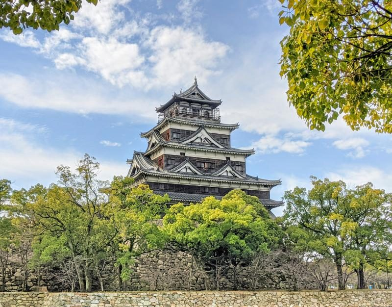View of Hiroshima Castle from the outside of the moat. Hiroshima Castle is a popular site to visit on your Hiroshima itinerary and when you're visiting Kyushu.
