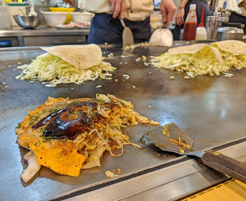 During your 2 days itinerary in Hiroshima, eat Hiroshima style okonomiyaki at Reichan.
