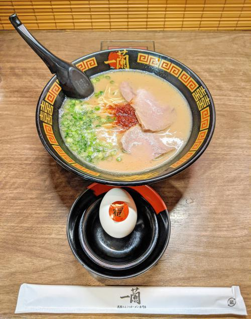 One of the places to eat in Fukuoka is Ichiran Ramen to try Hakata ramen with a soft boiled egg.
