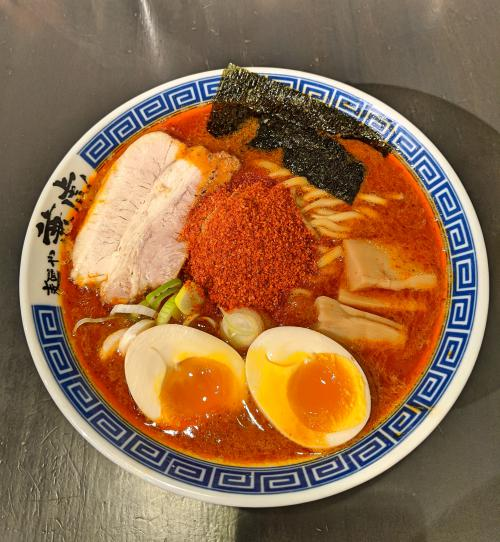 Try the crazy spicy Menya Kanetora ramen in Fukuoka, Japan. The broth is red due to the chili oil and spice.