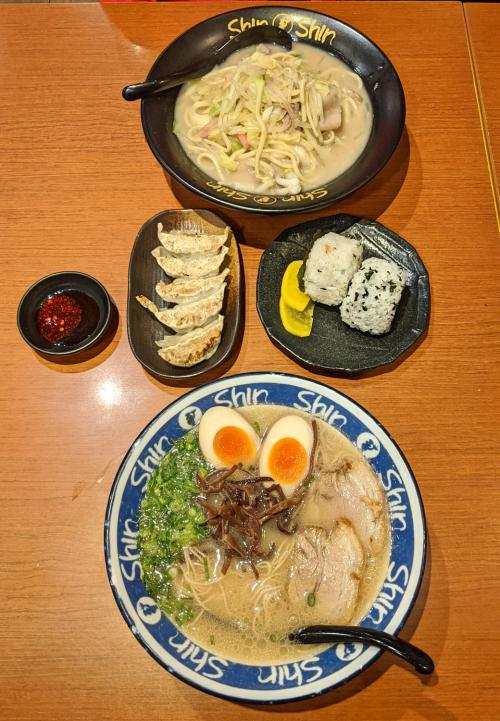 A bowl of Hakata ramen, champon, gyozas, and rice balls at Shin Shin Ramen in Fukuoka, Japan