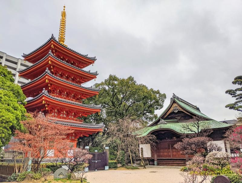 Five story red pagoda and temple in the Tochoji Temple area in Fukuoka, Japan. It's a fabulous place to visit on your one day in Fukuoka.