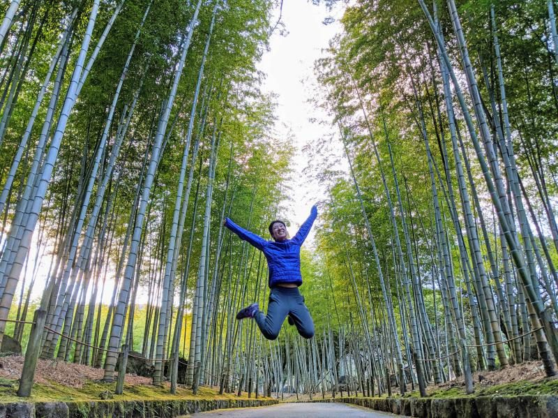 Jackie Szeto, from Life Of Doing, jumps in the middle of the bamboo forest area at Beppu Park in Beppu, Japan