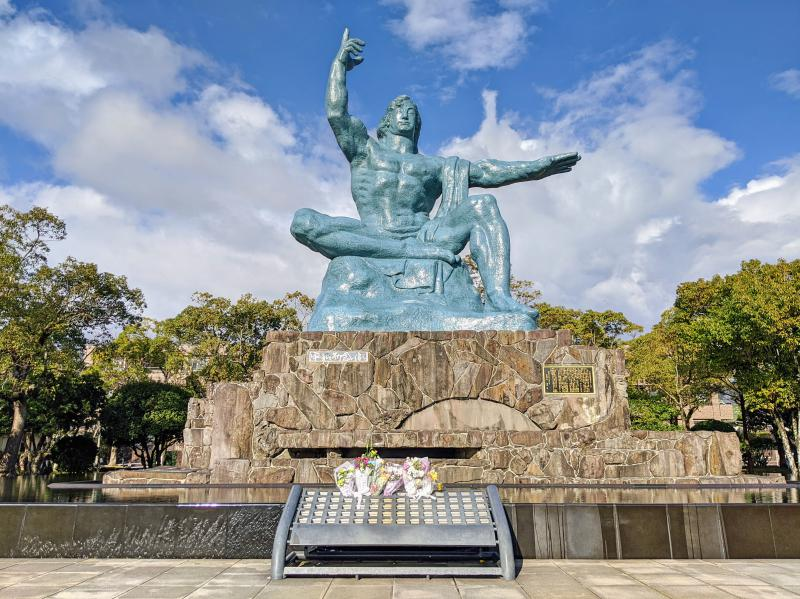 On your one day in Nagasaki itinerary, check out the bronze Peace Statue at the Nagasaki Peace Park. It's of a man holding up his right hand to the sky and left arm horizontally to show world peace.