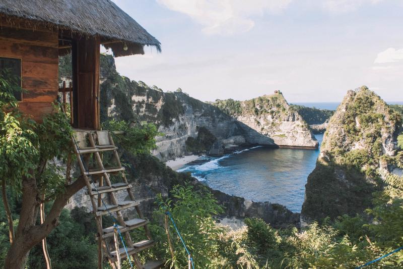 Rumah Pohon Treehouse overlooks the ocean and cliffside on Nusa Penida, Indonesia
