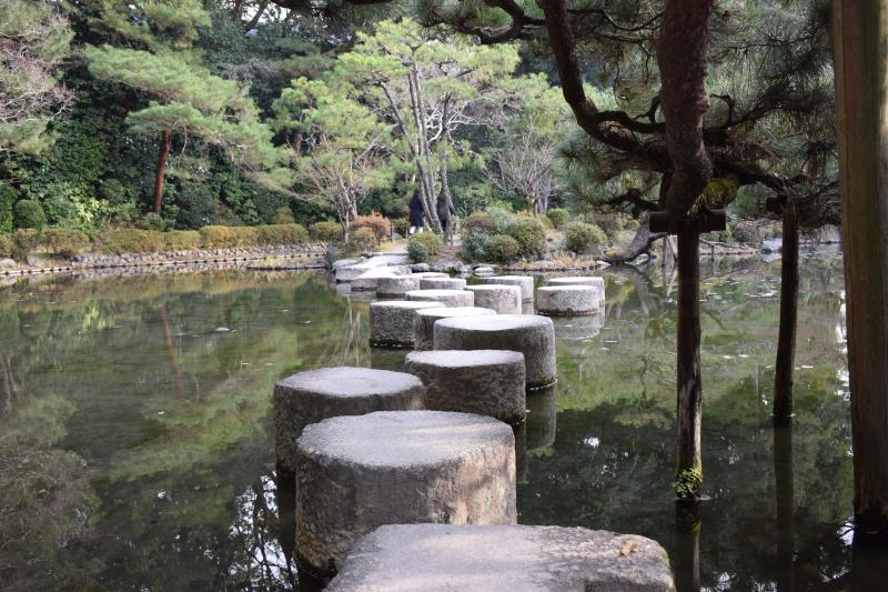 Stepping stones across the pond at the Heian Jingu Shrine in Kyoto, Japan