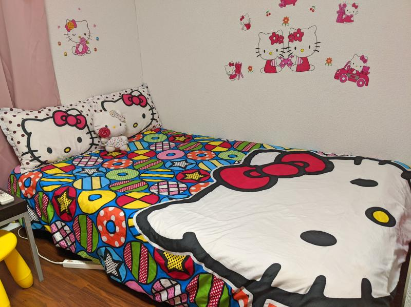 Our Airbnb in Osaka has a Hello Kitty theme with the bed comforter, pillows, stuffed animal, and wall stickers.