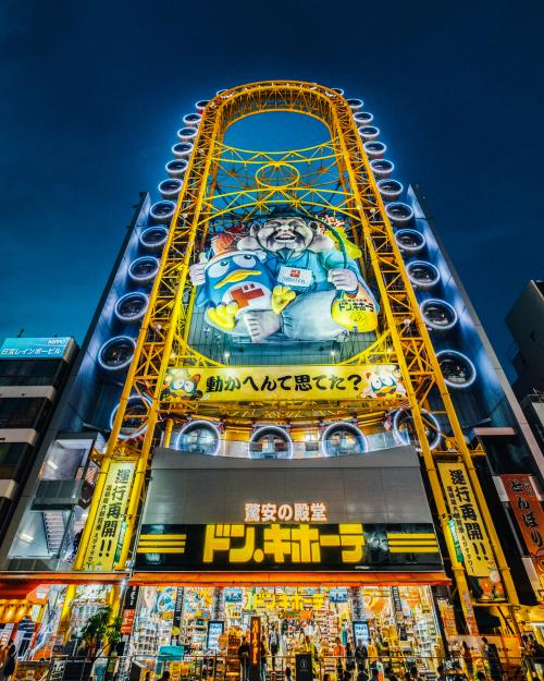 One of the famous landmarks in Osaka is the Don Quijote store in Dotonbori Street. It has the Don Quijote mascot and a Ferris Wheel.