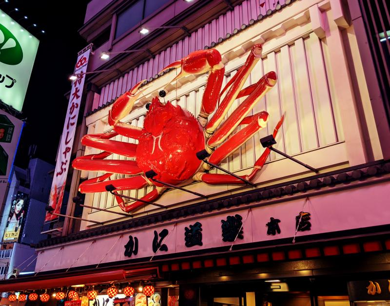 Check out the giant crab signage at the Kani Doraku Restaurant along Dotonbori Street in Osaka, Japan