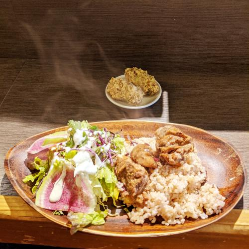 Jerk chicken with rice and beans and salad at Base Island Kitchen, a good place for cheap eats in Osaka, Japan