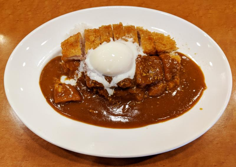 Oretachi No Curry-ya is a restaurant that has cheaper food options in Osaka. Choose your rice amount and side topping such as a soft boiled egg and tonkatsu.