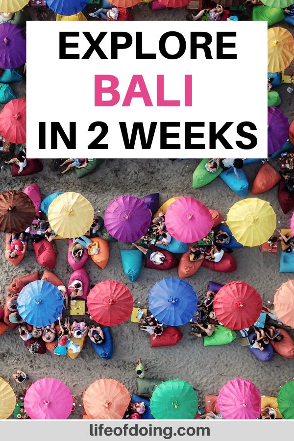 During your 2 weeks in Bali, hang out on the beaches with the colorful umbrellas and bean bag chairs.