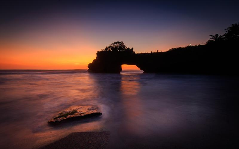 Silhouette of Tanah Lot during sunset in Bali, Indonesia