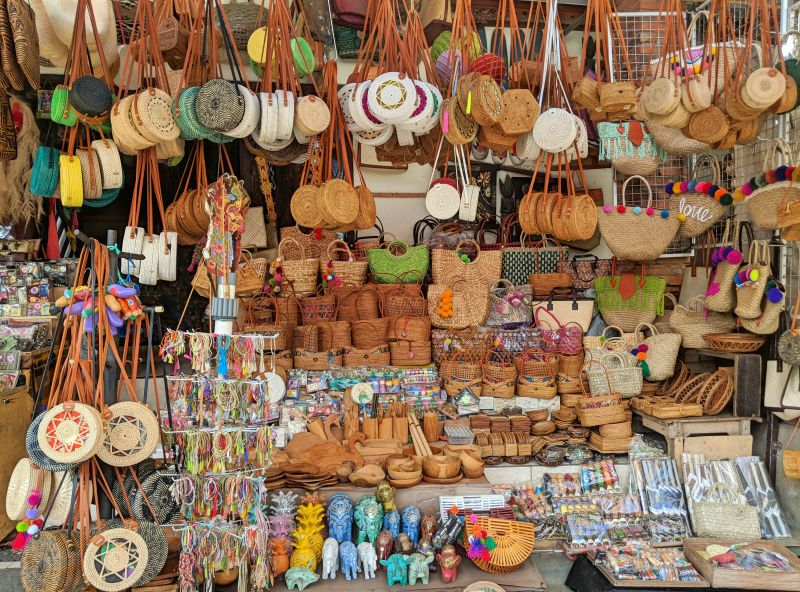 Rattan purses, handicrafts, and souvenirs available for purchase at the Ubud Art Market in Bali, Indonesia