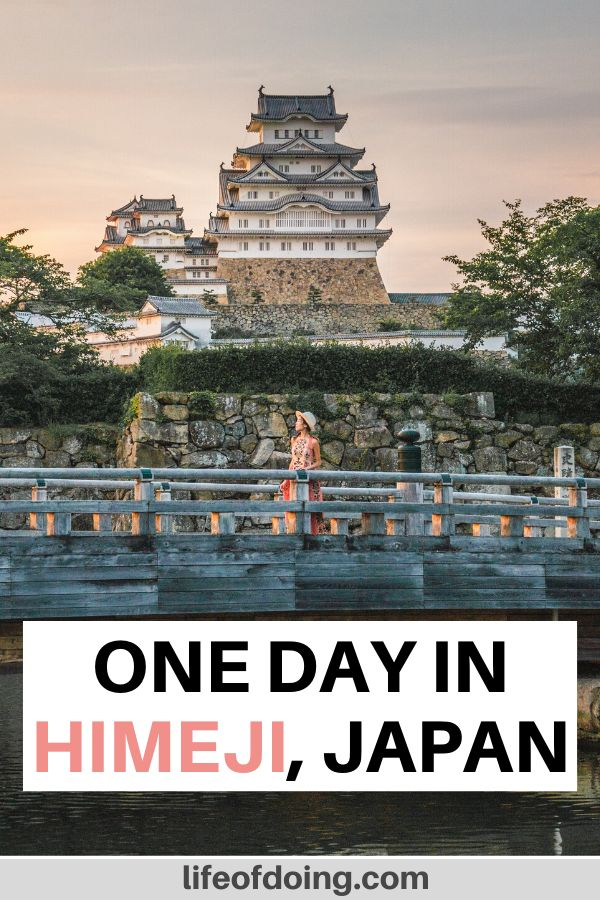 A woman is on the bridge with Himeji Castle in the background. This is one of the top places to visit in Himeji, Japan.