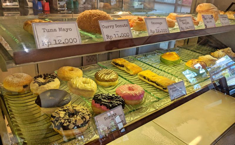 Donuts, croissants, and other baked goods in Kakiang Garden Cafe in Ubud, Bali.