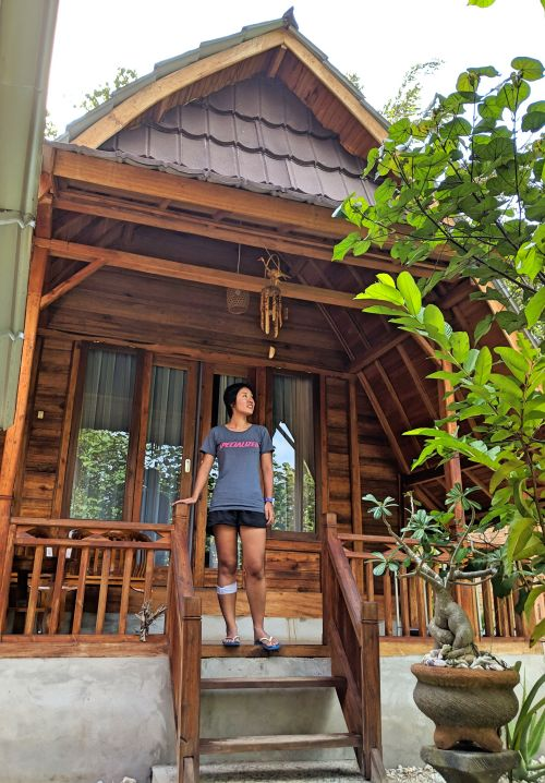 Jackie Szeto, Life Of Doing, stands in front of the private bungalow at Pudak Nature Bungalow in Nusa Penida, Indonesia.