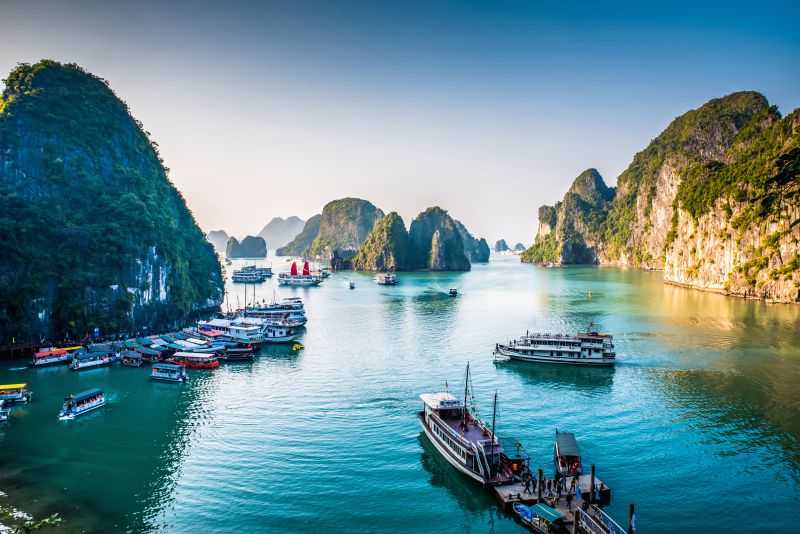 Views of junker boats in Halong Bay and the limestone mountains