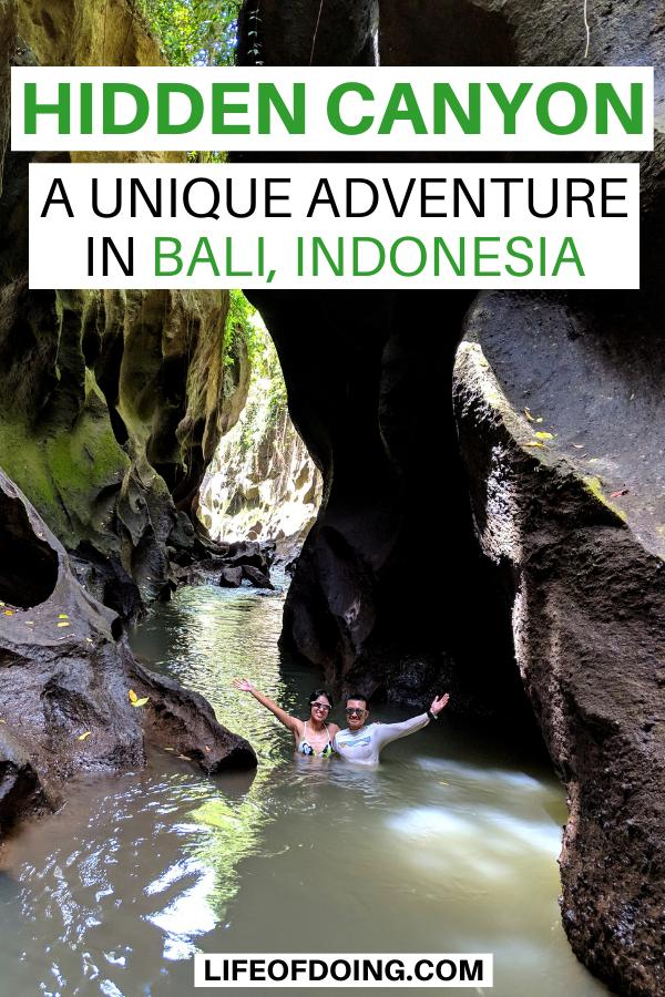Jackie Szeto and Justin Huynh, Life Of Doing, are waist-deep in the waters of Hidden Canyon (Hidden Canyon Beji Guwang) in Bali, Indonesia