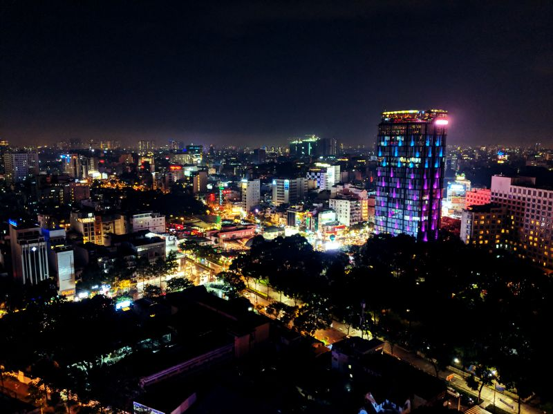 Night view of buildings and lights in Ho Chi Minh City, Vietnam from one of the rooftop bars