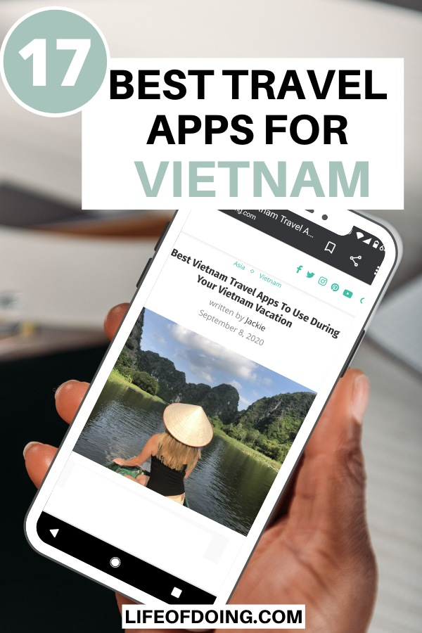 A hand holding a smartphone and reading about the top Vietnam travel apps to use.