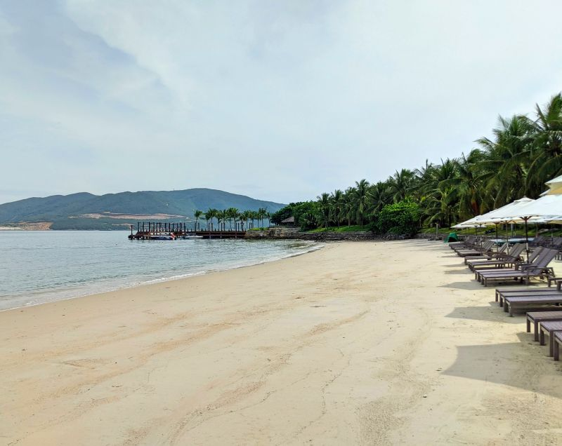 White sandy beach with lounge chairs at Hon Tam Beach on Hon Tam Island, Vietnam
