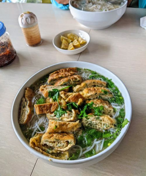 Rolled egg in rice noodle soup