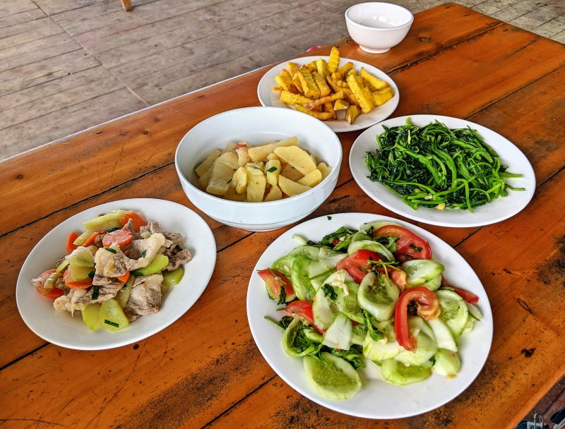 Lunch in Lao Chai Village of cucumber salald, pork with vegetables, boiled potatoes, morning glory vegetables, fried sweet pototoes, and rice